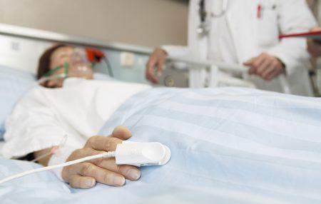 Doctor Watching Over Patient